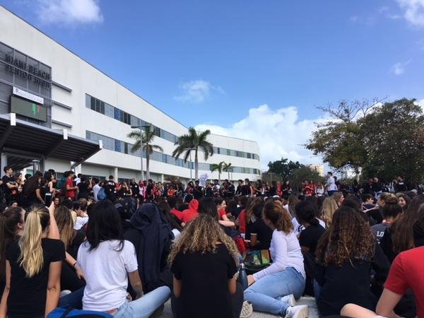 Students at Miami Beach Senior High walkout at noon to keep 17 moments of silence in remembrance of the 17 victims killed at the Parkland shooting.