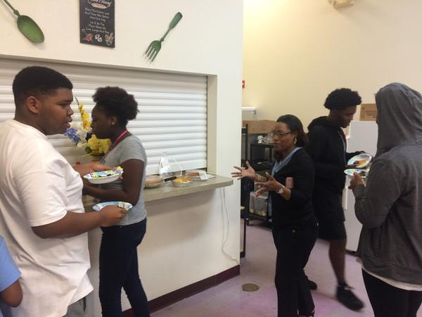 Students at Bethel Community Baptist Church prepare to judge a collard green cook-off.