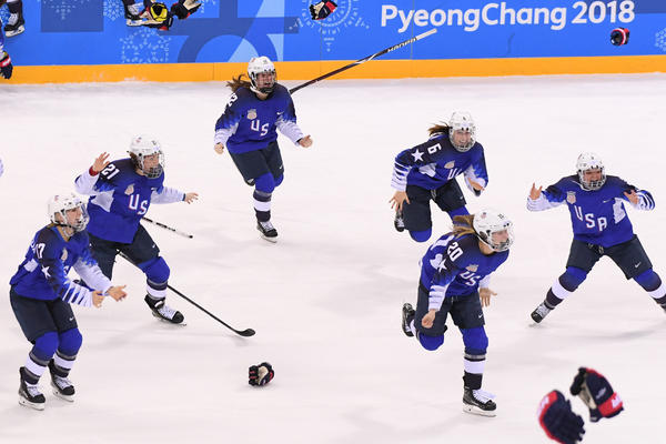The U.S. women's ice hockey team celebrates after defeating Canada 3-2 to win gold on Feb. 22.