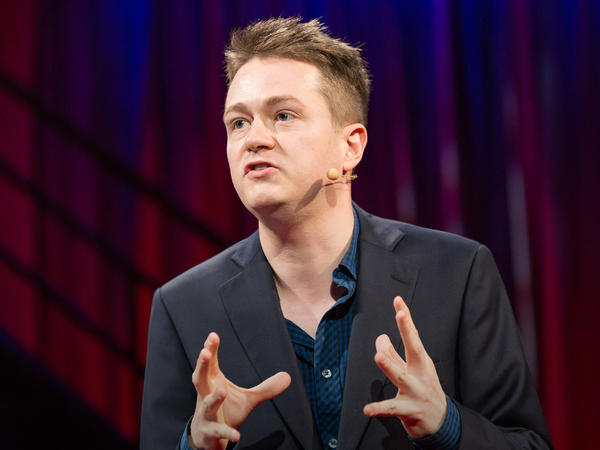 Johann Hari speaks on the TED stage.