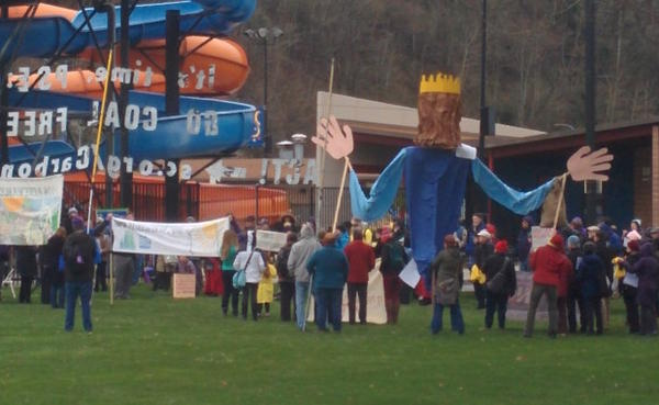 <p>Activists gather outside the Renton Community Center to protest Puget Sound Energy's plan to continue using electricity from coal.</p>