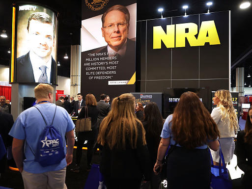 National Rifle Association CEO Wayne LaPierre's image floats above the NRA booth at the Conservative Political Action Conference this week in National Harbor, Md.