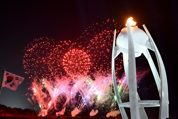 Fireworks light up the night sky outside the closing ceremony.