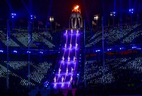 """Artists perform near the Olympic flame during the closing ceremony. """"Although parting is sad, we will remember Pyeongchang with beautiful memories,"""" said Lee Hee-beom, the Pyeongchang Olympics organizing committee president."""