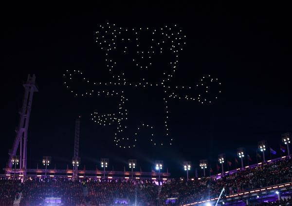 Drones light up the sky in the shape of Soohorang, the white tiger Pyeongchang Winter Olympic Games mascot. The winning athletes were given plush tigers in Soohorang's image.