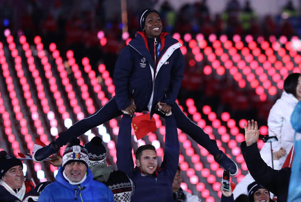 Figure skaters Vanessa James and Morgan Cipres of France march in the parade of athletes. Their music choices for their routines drew a lot of attention from the media and on YouTube.