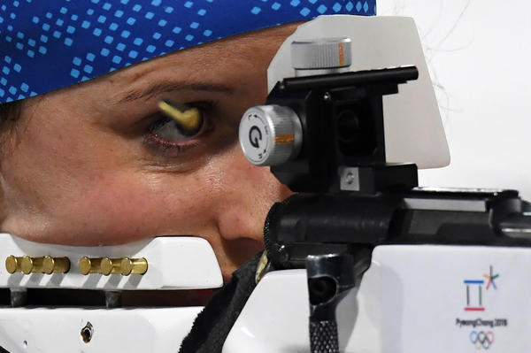 French biathlete Anais Chevalier competes at the shooting range in the women's 4x6-kilometer relay on Feb. 22. Her team won bronze.