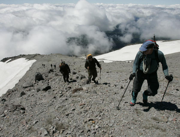 <p>Climbing above the clouds a group of climbers, including Mount St. Helens National Volcanic Monument scientist Peter Frenzen, second from right, climbs one of the final approaches to the crater rim of Mount St. Helens Thursday, July 13, 2006.</p>