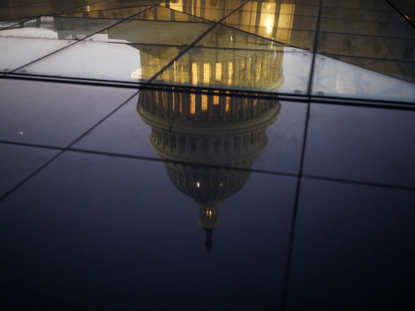 The U.S. Capitol is seen reflected in the windows of the Capitol Visitors Center. As Democrats seek to win the House in this year's midterms, they're relying on an online fundraising platform called ActBlue.