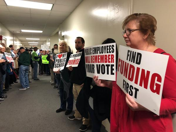 Teacher and state employee groups line the hallways leading to the committee room where lawmakers heard testimony on Senate Bill 1 on Feb. 28, 2018.