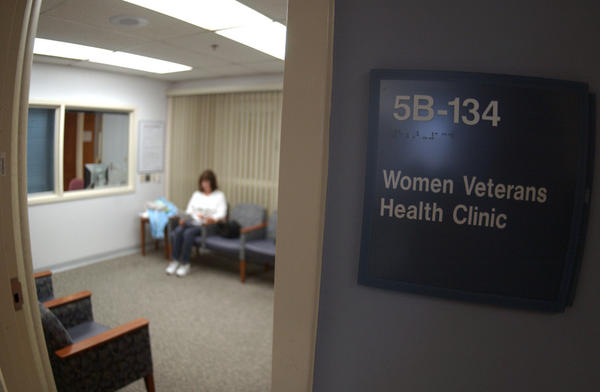 The Department of Veterans Affairs has sought to improve the care its hospitals offer to female veterans. In this file photo, a woman sits in a waiting room at the Veterans Affairs Medical Center in Martinsburg, W. Va.