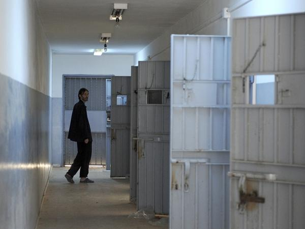 Matthew VanDyke walks  toward his former cell as he takes journalists on a tour of the Abu Salim  prison in the Libyan capital, Tripoli, on Tuesday.