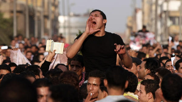 <p>Christians protest outside St. Mark's Cathedral in Cairo, a day after 25 people, mostly Christians, died in clashes with Egyptian security forces. </p>