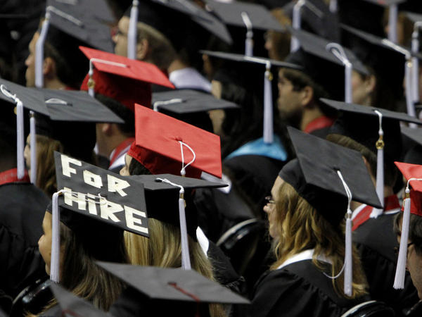 <p>Students attend graduation ceremonies at the University of Alabama in Tuscaloosa, Ala. Two-thirds of college students now graduate with debt, owing an average amount of $24,000.</p>
