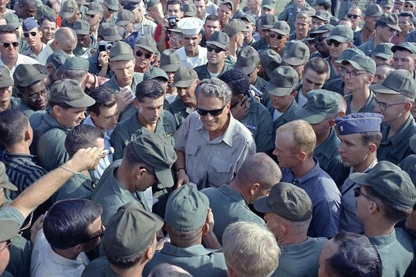 American servicemen in Vietnam greet Graham during a Christmas visit with troops on Dec. 21, 1966.
