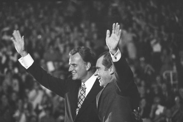 Graham often befriended presidents and presided over inaugurations, but his relationship with former President Nixon tested him. Graham reportedly initially refused to believe that Nixon had been involved in Watergate, only later realizing that he had misunderstood the president's character. The two wave to a crowd in Charlotte, N.C., on Oct. 15, 1971.