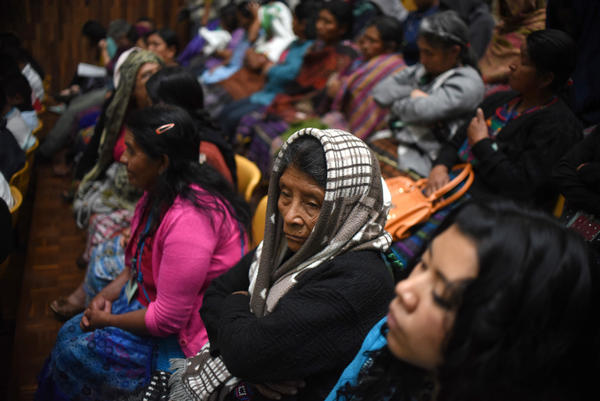 Indigenous people attend the trial of two army officers accused of keeping Mayan Indian women as sex slaves during Guatemala's 36-year civil war.