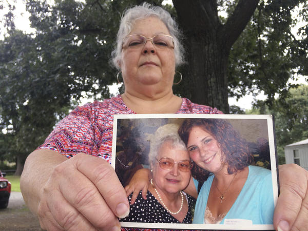 Susan Bro, the mother of Charlottesville victim Heather Heyer, holds a photo of Bro's mother and her daughter on Monday.