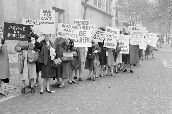 Pickets representing an organization known as Women Strike for Peace carry placards outside the United Nations headquarters in New York City, where the U.N. Security Council considers the Cuban Missile Crisis in a special meeting on Oct. 23, 1962.