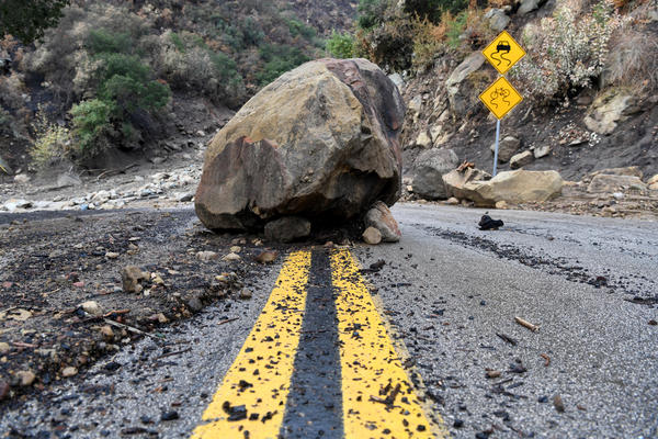 A large boulder sits in the middle of Bella Vista Drive in Montecito following the rainstorm.