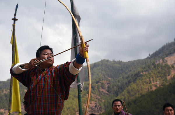 A Bhutanese archer draws and releases. Contestants must propel an arrow across a field that is 140 meters (460 feet) long, twice the distance of the range used in the Olympics.