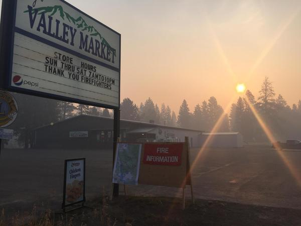 Wildfire smoke filled the sky in Seeley Lake, Mont. on Aug. 7, 2017. Weather effects concentrated the accumulating smoke, chronically exposing residents to harmful substances in the air.