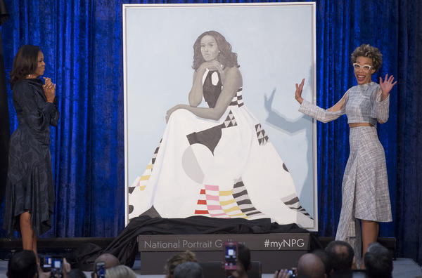 Former First Lady Michelle Obama (L) and artist Amy Sherald (R) unveil Mrs. Obama's portrait at the Smithsonian's National Portrait Gallery.