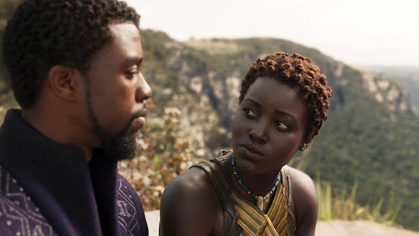 L to R: Chadwick Boseman as T'Challa/Black Panther and Nakia (Lupita Nyong'o) in <em>Black Panther.</em>