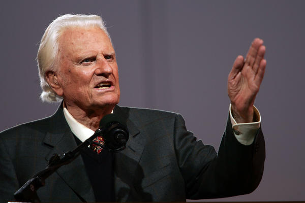 "Evangelist Billy Graham speaks in 2005 in Queens, N.Y. Graham was one of the most influential religious figures of the 20th century. Scholars say his death marks the end of a historical era, in which one person could unify Protestant Christianity and come to be known as ""America's pastor."""