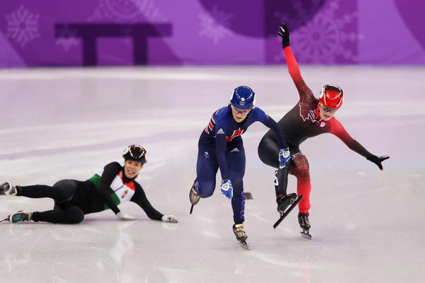 "Speedskaters Elise Christie of Great Britain gets by Kim Boutin of Canada and Andrea Keszler of Hungary as they fall during the Ladies' 500m quarterfinal on Feb. 13. ""If the pass is gonna be close or tight,"" says U.S. speedskater J.R. Celski, ""we usually say 'bombs,' like 'Uh-oh, something's gonna blow up!' So it's like an explosion. It most likely means people are falling."""