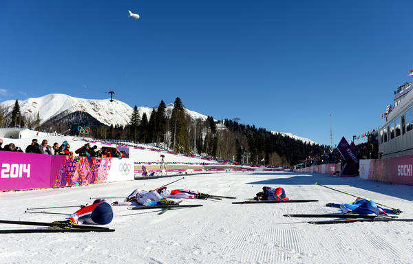 "Cross country skiers lie next to the finish line after competing in skiathlon at the Sochi 2014 Winter Olympics. ""If you 'bonk,'"" says gold medalist Jessie Diggins, ""it means you've just run out of energy, there's nothing left in the tank, and suddenly your body can't go on anymore."""