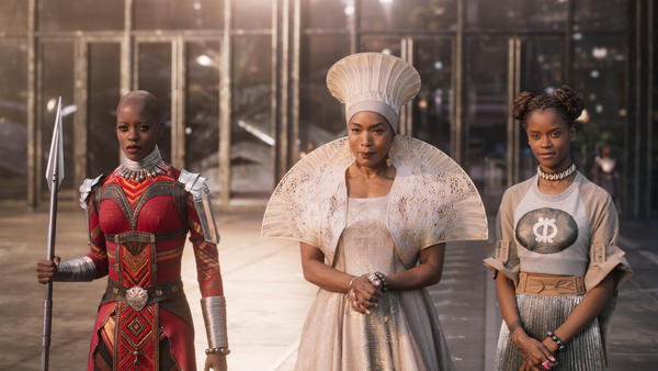 "Florence Kasumba (left), Angela Bassett and Leititia Wright appear in a scene from Marvel's <em>Black Panther</em>. Sociologist Darnell Hunt says the film's success ""demonstrates what's possible beyond standard Hollywood practices."""
