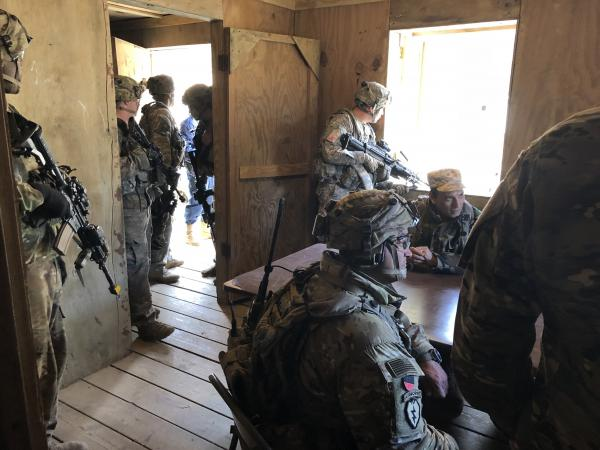U.S. soldiers with actors portraying Afghan officials as part of their training to be advisers.