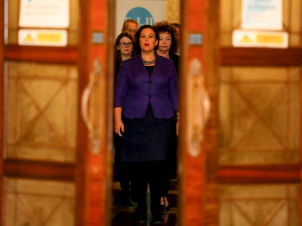 Sinn Fein president Mary Lou McDonald arrives to speak to the media at the Parliament Buildings in Belfast on Feb. 12. She supports same-sex marriage and ending Ireland's abortion ban, but critics warn that she's tied to many of her party's hard-line policies.
