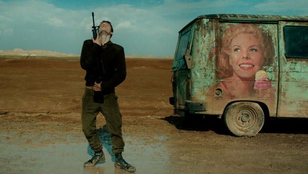 At a lonely checkpoint, an Israeli  soldier (Itay Exlroad) dances with his weapon in <em>Foxtrot</em>.