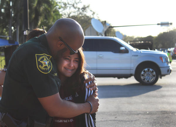 Deputy Bernard Hilson greeted students with hugs as they walked into Marjory Stoneman Douglas High School on Wednesday, February 28, for the first time since the shooting.