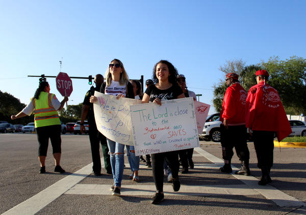 Some community memebers brought posters and sang to welcome the students of Marjory Stoneman Douglas High School on their first day back since the shooting.