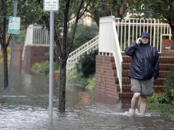A resident in Norfolk, Va., after tropical storm Ida in 2009. New zoning rules require builders to include flood protection measures.