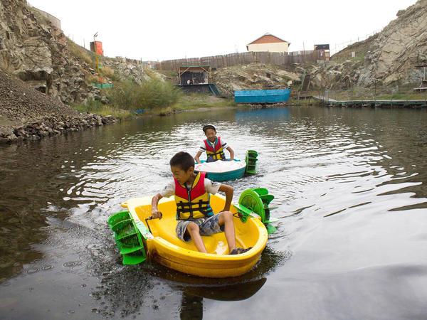 Kids boat in the community lake.