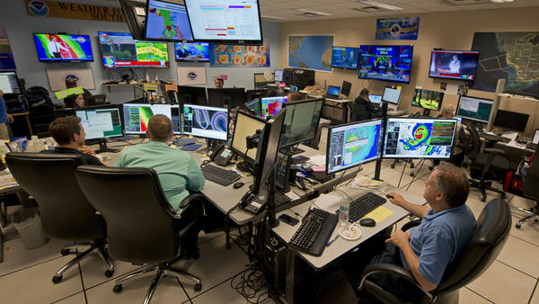 Forecasters at the National Weather Service office monitor Hurricane Irma on Sept. 9, 2017, at the hurricane center in Miami.