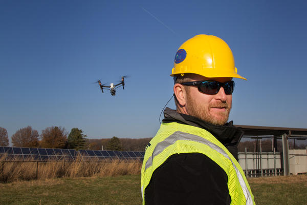 In his new job as a commercial drone pilot, former Army helicopter pilot Tony Zimlich directs a drone-powered field site inspection of a Pennsylvania solar farm.