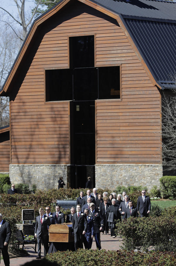 The casket of the Rev. Billy Graham is moved during his funeral service at the Billy Graham Library on Friday in Charlotte, N.C.
