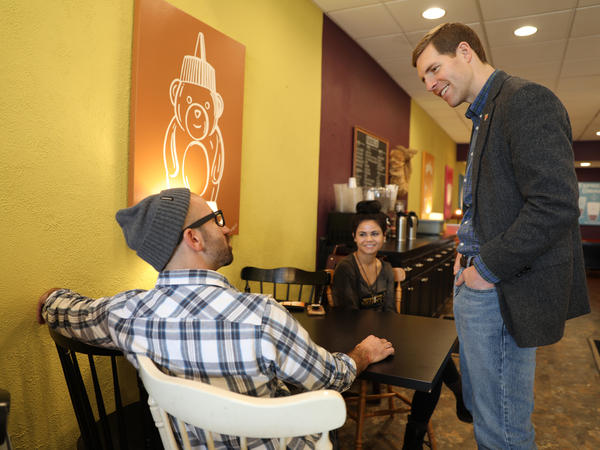 Democrat Conor Lamb, right, chats with Justin Torrence and Chelsea Carbonyl, left and center, while campaigning for the U.S. House of Representatives in Mount Lebanon, Pa., on Feb. 28.