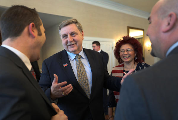 Republican candidate for the U.S. House of Representatives Rick Saccone and his wife Yong Saccone chat with supporters at a fundraiser at Southpointe Golf Club in Canonsburg, Pa., on Feb. 28.