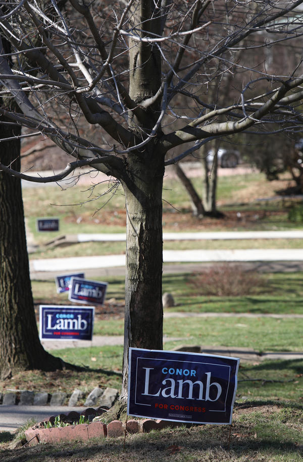 Democratic candidate for U.S. Congress Conor Lamb has signs up in Mount Lebanon, Pa., on Feb. 28.