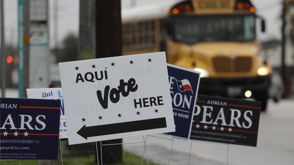 Signs mark a polling site as early voting begins began on Feb. 20 in San Antonio. Early voting in Texas ran through last Friday, March 2.