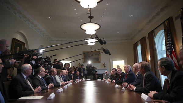 President Trump participates in a meeting with leaders of the steel and aluminum industries at the White House Thursday.
