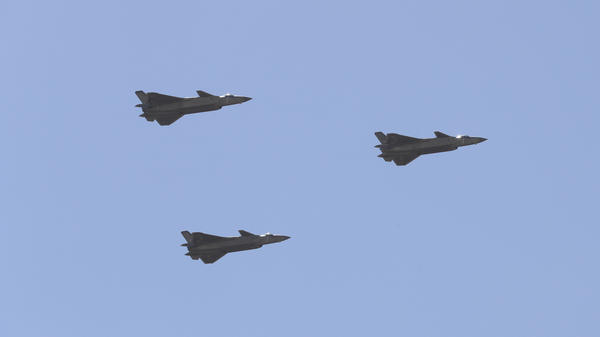 Chinese J-20 stealth fighter jets fly past during a military parade at the Zhurihe training base in China's northern Inner Mongolia region in July.