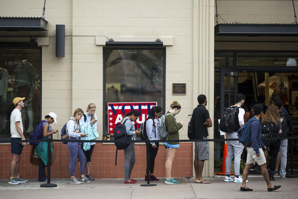 Voters line up outside of The University Co-op across from the University of Texas at Austin.
