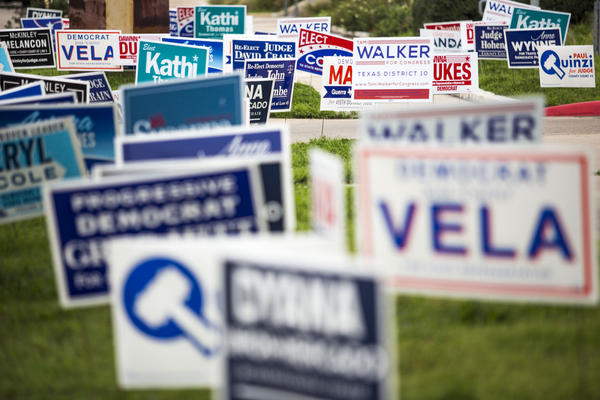 Campaign signs outside of the Carver Public Library in East Austin - an early polling location for the 2018 elections in Travis County.